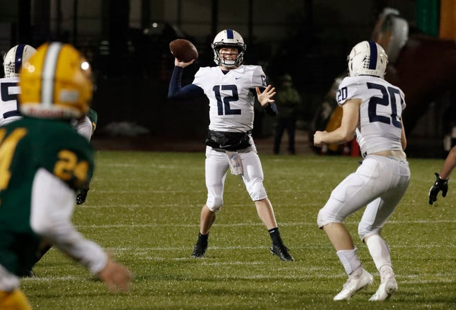 Central Valley Christian's quarterback, Max Bakker, passes downfield against Kingsburg during the first half of their football game in Kingsburg, Calif. Friday, March 19, 2021.