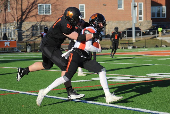 Mamaroneck's Matthew Sommer (51) tackles White Plains quarterback Jay Biondi during the Mamaroneck-White Plains football game on Friday, March 19, 2021.