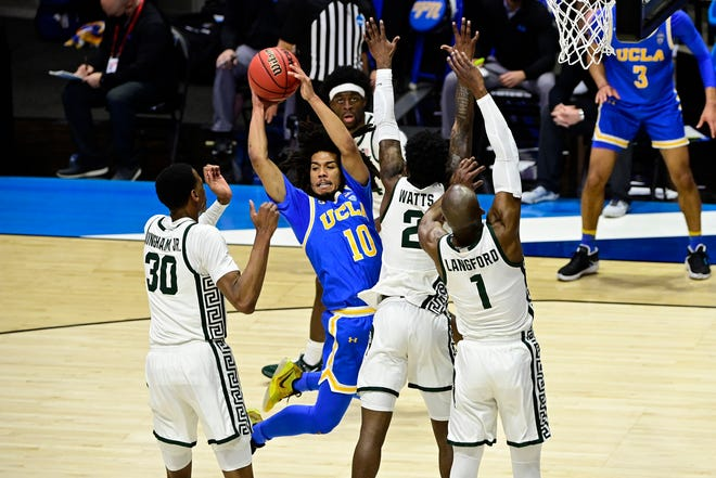 UCLA guard Tyger Campbell (10) controls the ball against Michigan State during the second half of their First Four game of the 2021 NCAA Tournament at Mackey Arena.