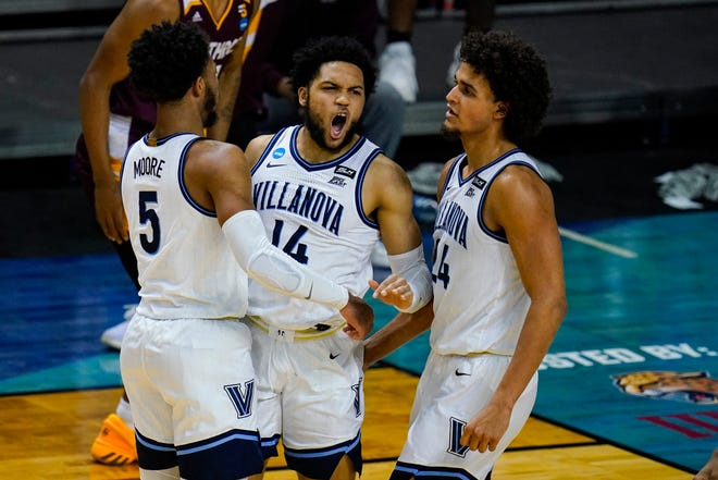 Villanova goalkeeper Caleb Daniels (14) celebrates a defensive pause with Justin Moore (5) and Jeremiah Robinson-Earl (24) in the second half of the first-round match against Winthrop in the NCAA Men's College Basketball Championships at Farmers Coliseum in Indianapolis Friday, March 19, 2021.