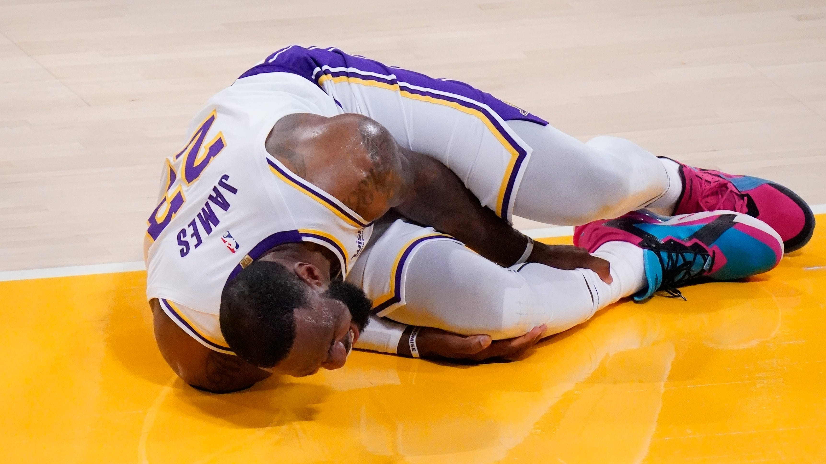 LeBron James yells in pain after turning his right ankle in the second quarter of Saturday's 99-94 loss to the Atlanta Hawks. The Lakers diagnosed James with a high right ankle sprain and ruled him out indefinitely.