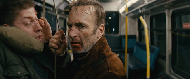 "Hutch Mansell (Bob Odenkirk) hangs up a thug (Alain Moussi) on the bus in the action thriller ""Nobody."""