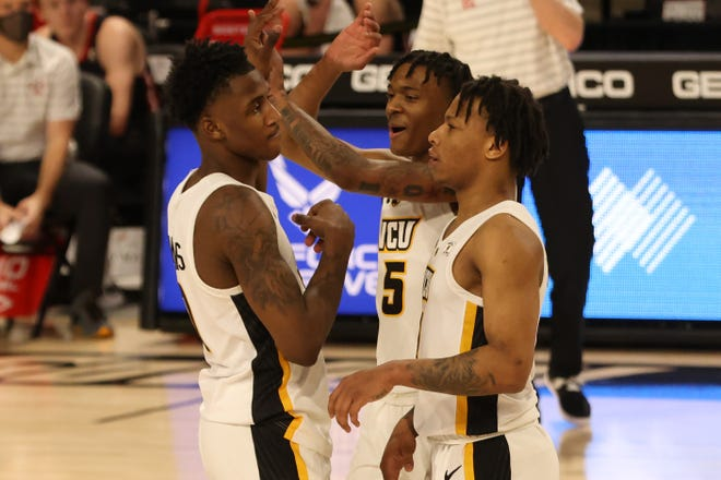 Virginia Commonwealth forward Jamir Watkins (0) celebrates with guard Nah'Shon Hyland (5) and guard Adrian Baldwin Jr. (1)  during the Atlantic 10 conference tournament at Stuart C. Siegel Center.