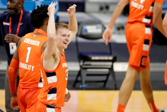 First round: Syracuse guard Buddy Boeheim, who scored 30 points on a red-hot shooting night, celebrates the Orange's 78-62 win against San Diego State.