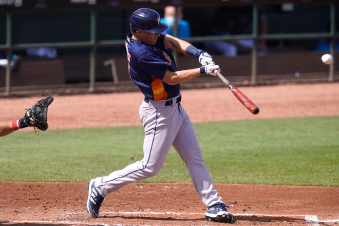 Houston Astros' Myles Straw hits a triple during a preseason game versus the Miami Marlins earlier in the month. Straw will be the likely replacement for George Springer, former star centerfielder for the club who signed with the Toronto Blue Jays in the offseason.