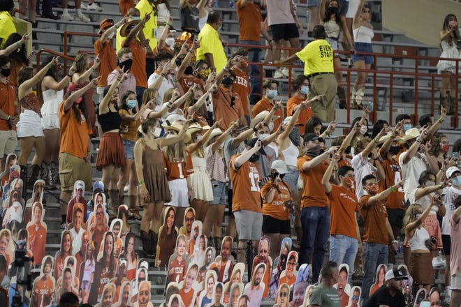 """Fans join in singing """"The Eyes of Texas"""" after Texas defeated UTEP 59-3 in an NCAA college football game in Austin on Sept. 12, 2020. [AP PHOTO/CHUCK BURTON/FILE]"""