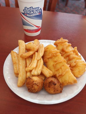 The Arthur Treacher's fish and chips meal with hush puppies Friday, March 19, 2021 in Cuyahoga Falls, Ohio.