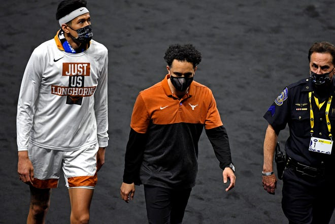 Texas head coach Shaka Smart walks off the court after Saturday night's 53-52 loss to Abilene Christian in the first round of the NCAA Tournament.  UT officials must now consider the future of Smart's tenure after six years and zero NCAA victories.