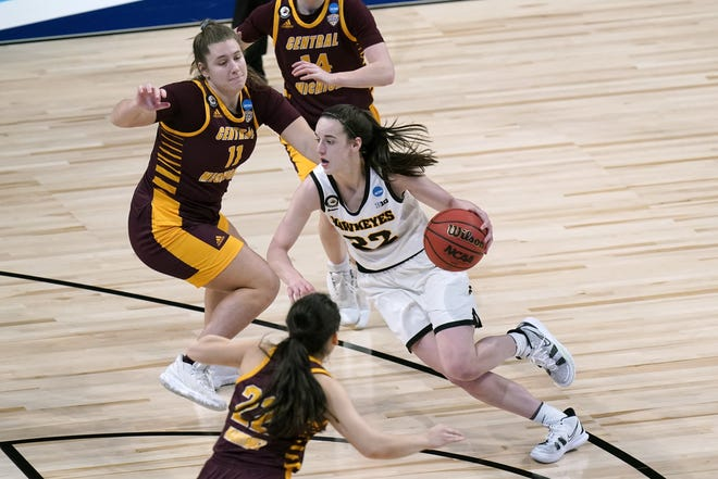 Iowa guard Caitlin Clark drives past Central Michigan guard Micaela Kelly during the Hawkeyes' 87-72 win in the first round of the women's NCAA Tournament at the Alamodome on Sunday. The do-it-all freshman had 23 points, seven rebounds and seven assists in the victory.