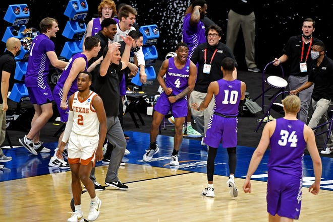 Texas guard Matt Coleman III walks away as Abilene Christian's bench reacts after a play in the second half of ACU's 53-52 win in the first round of the NCAA Tournament. The third-seeded Longhorns committed a season-high 23 turnovers.