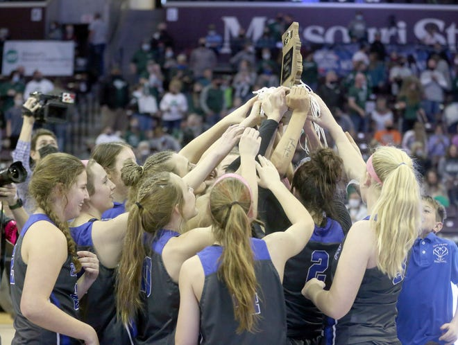 Members of the Boonville girls basketball team hoist the trophy after beating Mt. Vernon 58-52 in the Class 4 state championship game Saturday at JQH Arena in Springfield.