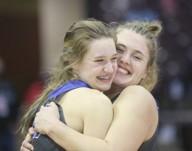 Boonville seniors Brooke Eichelberger and Kourtney Kendrick celebrate after beating Mt. Vernon 58-52 for the Class 4 state championship Saturday in Springfield.