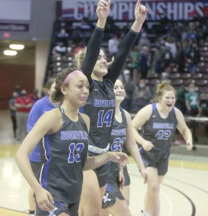 Members of the Boonville girls basketball team celebrate the first state title in program history Saturday at JQH Arena in Springfield.