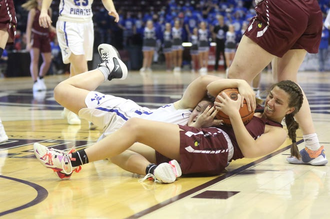 Boonville junior Emma West battles for a loose ball against a Benton player in the first half Friday in a Class 4 semifinal game in Springfield.