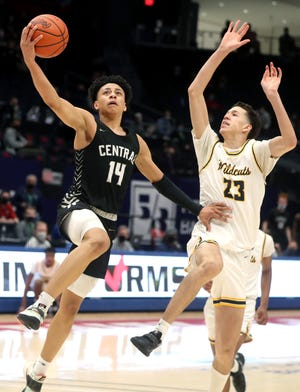 Quincy Clark (14) of Westerville Central drives in for a layup in Saturday's Division I state semifinal victory over Cleveland St. Ignatius.
