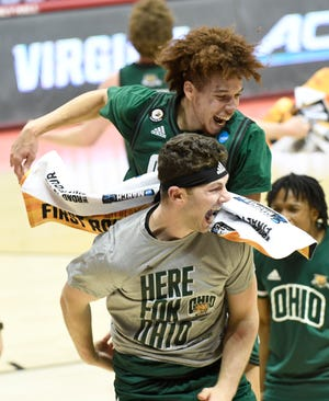 """Ohio guard Jason Preston jumps on the back of a teammate after a first-round win over Virginia on Saturday night. Coach Jeff Boals, when asked about the Bobcats' bandwagon, said, """"Keep coming. Hopefully, we'll keep this thing going and we'll take every Bobcat fan that we can get."""""""