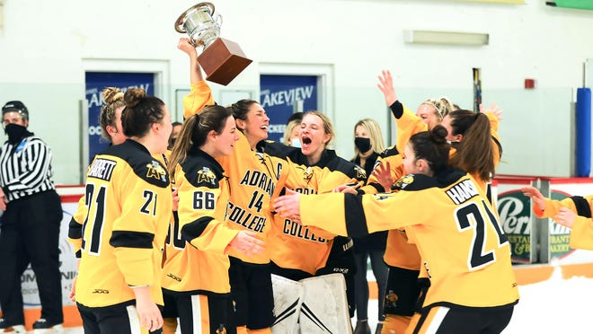 The Adrian College women's hockey team celebrates after sweeping the NCHA Slaats Cup finals against St. Scholastica with Saturday's 3-1 victory.
