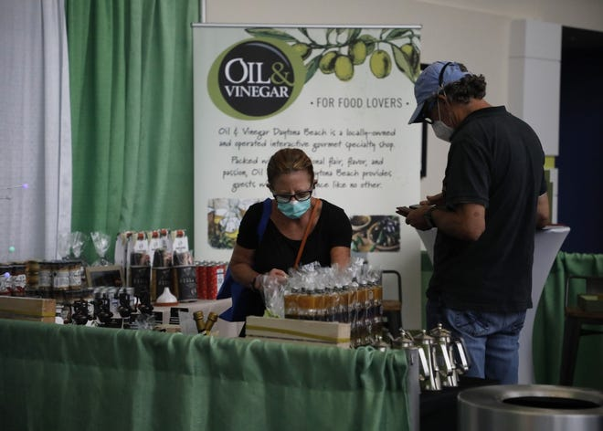 Guests shop at the Oil & Vinegar Daytona booth on the last day of the 32nd Annual Daytona Beach News-Journal Spring Home Show at the Ocean Center on Sunday, March 21, 2021.