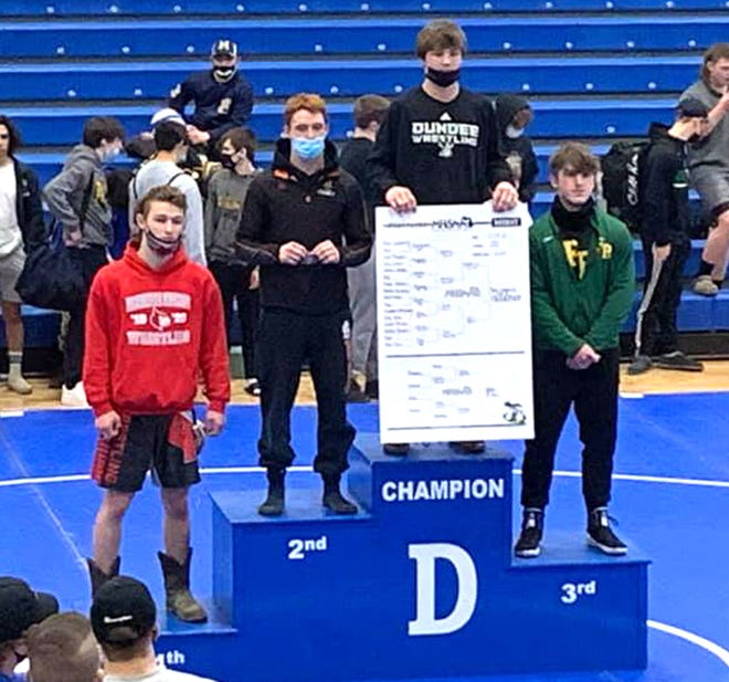 Quincy's Gerl Pish, second from left, took runner-up honors at 160 pounds Saturday