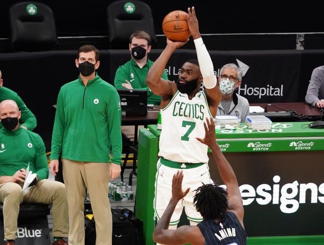 Mar 21, 2021; Boston, Massachusetts, USA; Boston Celtics guard Jaylen Brown (7) shoots against Orlando Magic forward Al-Farouq Aminu (2) in the third quarter at TD Garden.