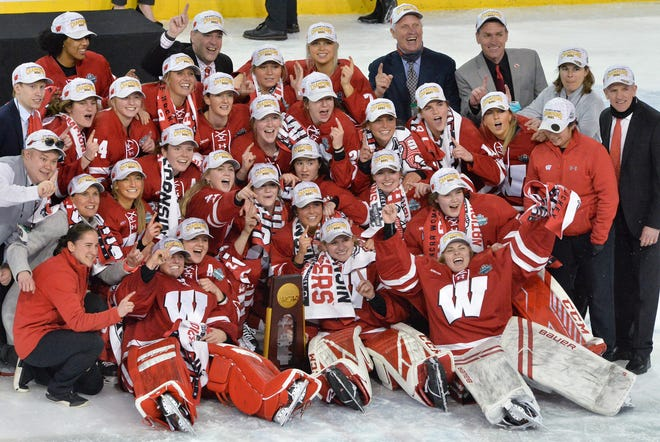 University of Wisconsin teammates celebrate their 2021 NCAA Women's Frozen Four hockey tournament championship 2-1 win over Northeastern University on March 20, 2021, at Erie Insurance Arena in Erie.