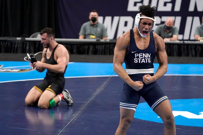 Penn State's Carter Starocci, right, celebrates after defeating Iowa's Michael Kemerer during their 174-pound match in the finals of the NCAA wrestling championships Saturday, March 20, 2021, in St. Louis.