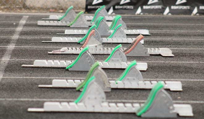 Starting blocks are lined up at the start of the girls 100-meter hurdles at the Bob Hayes Invitational Track Meet on March 20, 2021. [Clayton Freeman/Florida Times-Union]