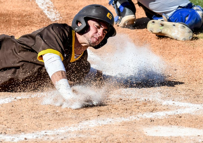 Garden City Community College's Ibrahim Rodriguez slides safely into home plate to score off a sacrifice fly by Kyle Jameson Friday against Pratt at Williams Stadium.