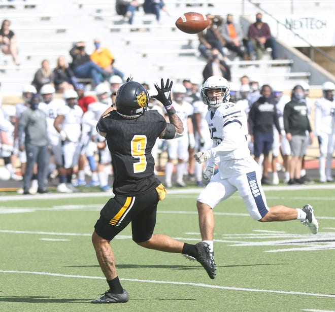 FHSU receiver Diante Crutchfield gets set to haul in a pass from quarterback Chance Fuller. Crutchfield scored on the play for a 74-yarder.