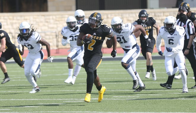 Fort Hays State's Keylan Chapman breaks away from the SWOSU defense during Saturday's scrimmage at Lewis Field Stadium.