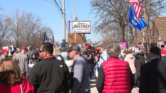 Supporters of Holland restaurant owner Marlena Pavlos-Hackney protest her jailing Saturday, March 20, after she ignored the state's dine-in ban and a license suspension of the restaurant.