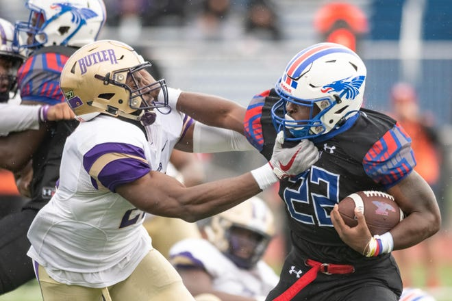 Hutchinson Community College's Kendall Cross (22) holds off Butler's Marvin Pierre (20) in the second quarter Saturday, Sept. 28, 2019. Hutchinson defeated Butler 35-28.