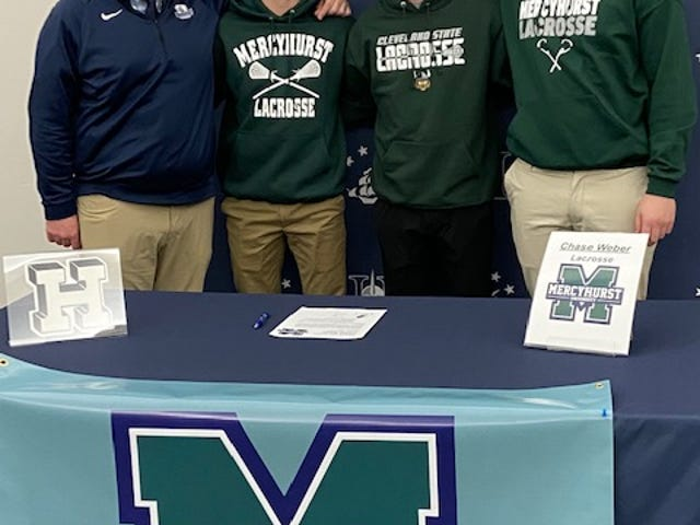 Three Hudson boys lacrosse seniors have committed to continue their careers in college. Left to right, coach Brandon Schwind, Adam Oscarson (Mercyhurst University), Matt Mehelic (Cleveland State University), Chase Weber (Mercyhurst University).