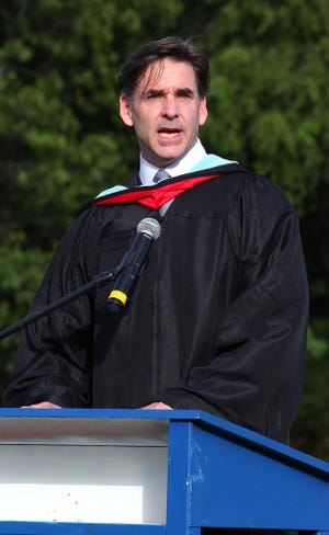 In this file photo, former Scituate High School Principal Robert Wargo speaks during a graduation ceremony in 2014. Wargo is the new superintendent for Weymouth Public Schools.