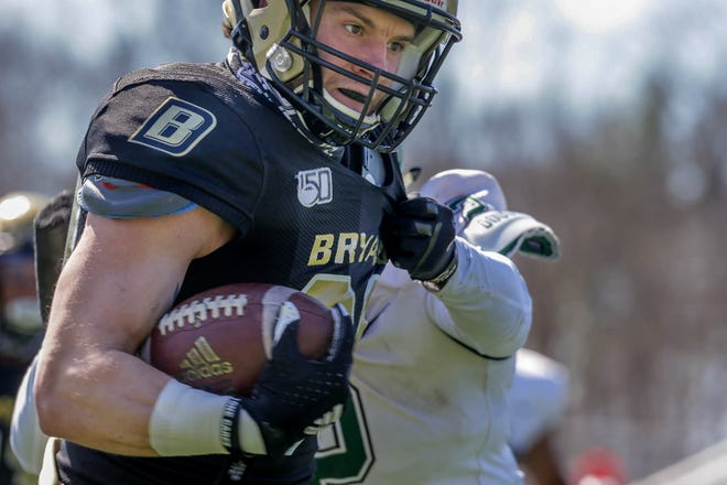 Bryant wide receiver Alex Rasmussen hauls in a pass from quarterback Ryan Clark for a huge gain in the first quarter on Sunday, setting up a Bulldogs touchdown.