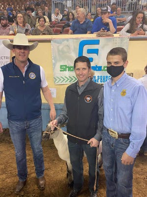 Sen. Zack Taylor and Chandler FFA student Jared Stone with Gov. Kevin Stitt.