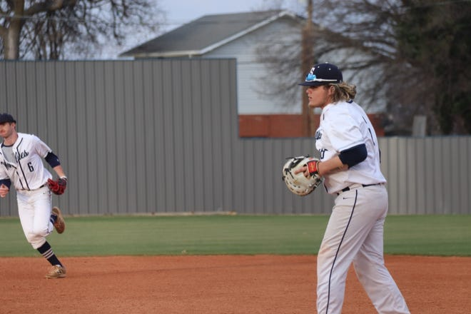 Shawnee first baseman Koby Mitchell (right) prepares to step on first base after fielding the ball against the Oklahoma City Broncos earlier this season. At left is second baseman Bauer Brittain.
