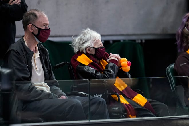 Sister Jean Dolores Schmidt watches Loyola Chicago play Illinois during the first half of a men's college basketball game in the second round of the NCAA tournament at Bankers Life Fieldhouse in Indianapolis, Sunday, March 21, 2021.