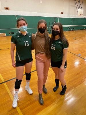 Grafton coach Alyssa Cafarelli, center, with captains Lizzie Cross, left, and Rachel Gilliatt, right.