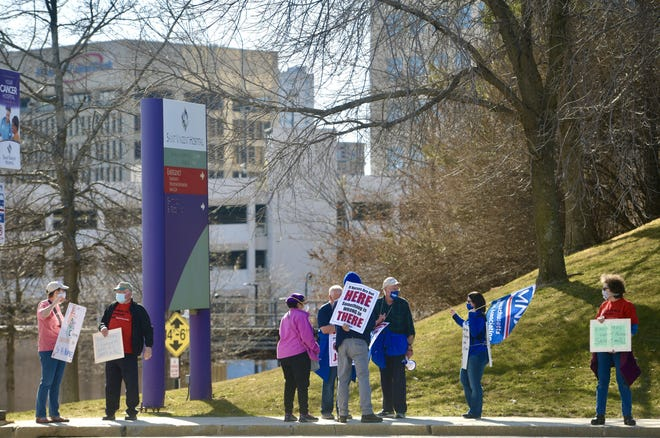 Nurses and their supporters walk the picket line outside St. Vincent Hospital on Sunday in Worcester.