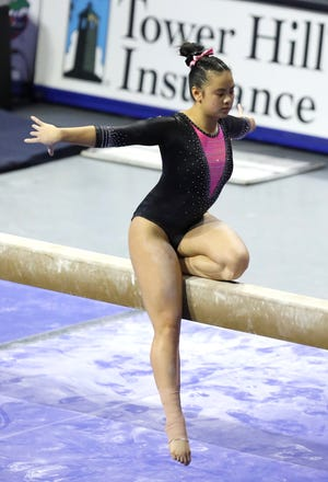 Florida gymnast Ellie Lazzari competes on the beam during a meet against Kentucky at Exactech Arena in Gainesville last month. She claimed a share of the SEC Championship beam title Saturday with teammate Alyssa Baumann .