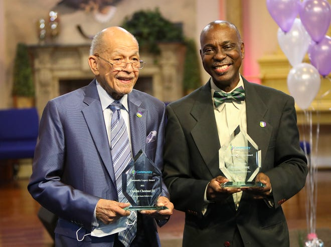 Charles Chestnut III, left, and Rodney Long, smile after receiving their awards during the Community Legacy Awards Ceremony from Community Hospice & Palliative Care, held at Showers of Blessings Harvest Center in Gainesville on March 17.  [Brad McClenny/Special to The Guardian]