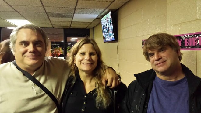 Paul Andre Michels, right, with sister Sarah Michels and brother John Michels in Allen Park in October 2015. Paul Michels was killed during the March 16, 2021 Georgia spa shootings.