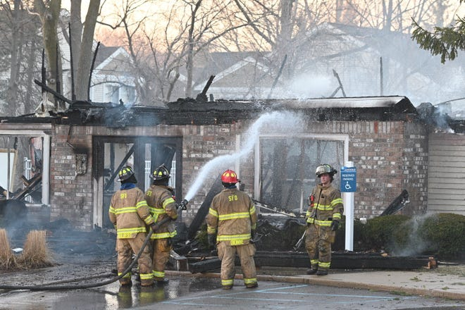 Firefighters extinguish a fire at the main office of the Monticello Apartments in Southfield on Saturday, March 20, 2021.