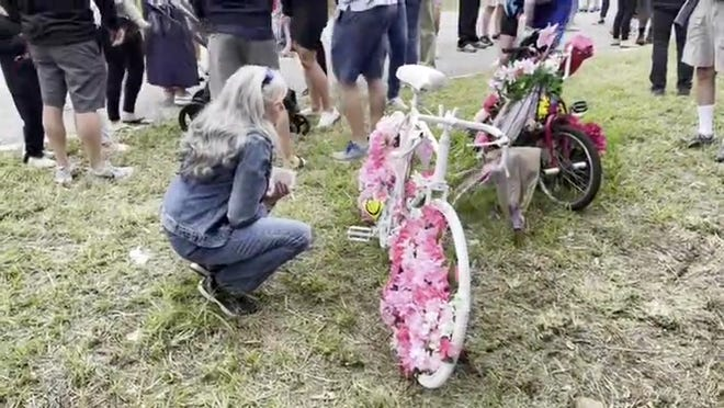 A ghost bike to honor Debra Purcaro, killed in the crash, and Cristin Madden, seriously hurt by the hit-and-run driver