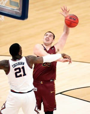 Illinois Fighting Illini center Kofi Cockburn (21) blocks Loyola (Il) Ramblers center Cameron Krutwig (25) during the second round of the 2021 NCAA Tournament on Sunday, March 21, 2021, at Bankers Life Fieldhouse in Indianapolis, Ind.