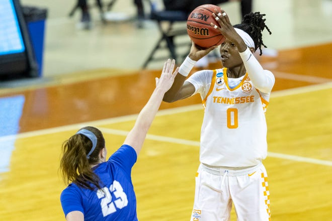 Tennessee guard Rennia Davis, right, looks to shoot against Middle Tennessee in the NCAA Tournament. The former Ribault standout finished her college career in the Lady Vols' all-time top 10 in multiple categories.