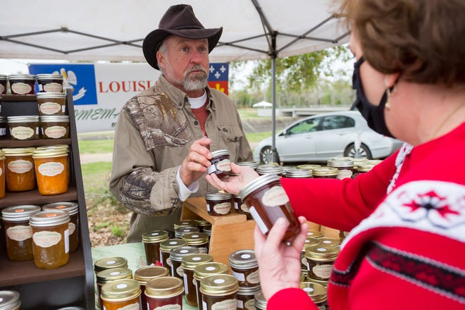 Gene Josey with Joseys Goods serving customers at the Farmers Market. Saturday, March 20, 2021.
