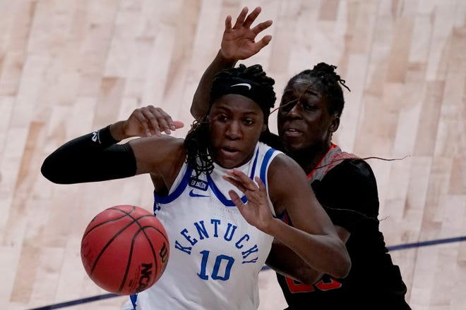 Kentucky guard Rhyne Howard (10) and Idaho State guard Diaba Konate battle for a rebound during the second half of a college basketball game in the first round of the women's NCAA tournament at the Alamodome in San Antonio, Sunday, March 21, 2021. Kentucky won 71-63. (AP Photo/Charlie Riedel)