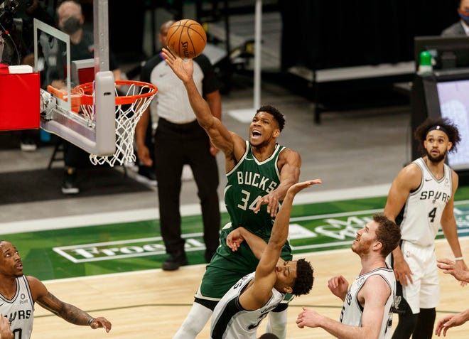 Bucks forward Giannis Antetokounmpo puts up a shot over Spurs guard Keldon Johnson on March 20 when the teams last met.